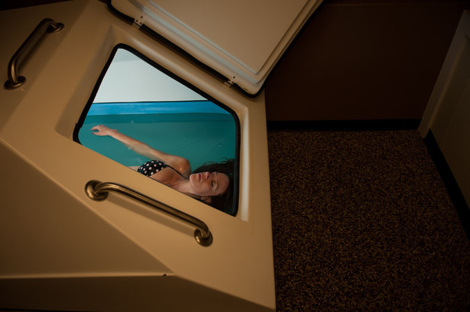 Amela Corbadzic, afloat in a sensory deprivation tank last month at Healing Waters Mind and Body Float Studio in Northglenn, Colo. Credit Theo Stroomer for The New York Times